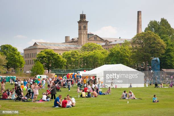 families sat on the green in roberts park - bradford england stock pictures, royalty-free photos & images