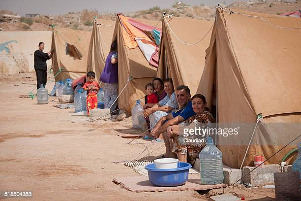 Families sitting in refugee camp