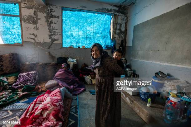 Families sleep in an halfdestroyed houses littered with hidden explosives An estimated 400000 refugees fleeing the twomonthold Turkish military...