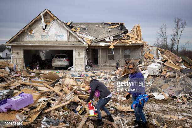 Families sort through tornado debris to gather possessions on March 4 2020 in Cookeville Tennessee A tornado passed through the Nashville area early...