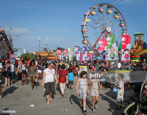 Families stroll along and have fun on the kids midway rides at the Canadian National Exhibition