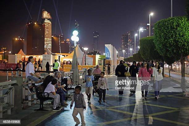 Families stroll down the Corniche on February 5 2015 in Abu Dhabi United Arab Emirates Abu Dhabi is the capital of the United Arab Emirates and the...