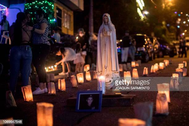 Families take part in the Day of the Little Candles celebration at the Comuna 13 in Medellin Colombia on December 7 2018 The Day of the Little...