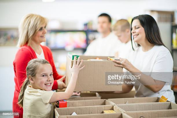 Families Volunteering Together in a Food Shelter