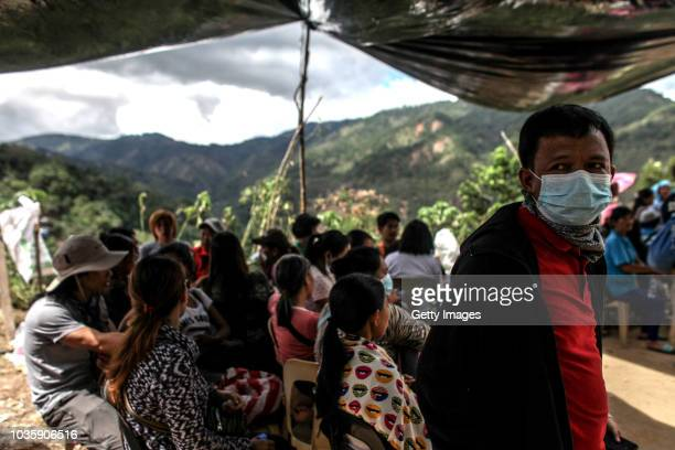 Families wait for the bodies of their loved ones who were killed by a landslide on September 19 2018 in Itogon Benguet province Philippines Dozens of...