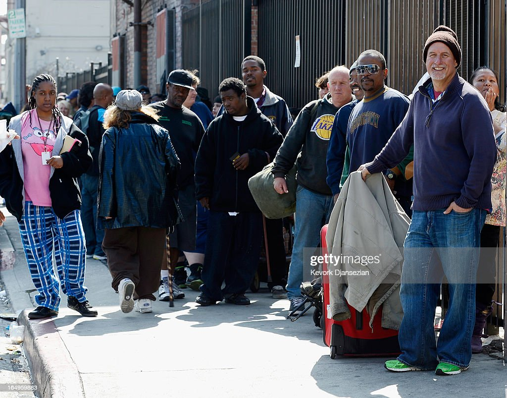 Families wait in line for dinner on Good Friday during the Skid Row Easter event at the Los Angeles Mission on March 29, 2013 in Los Angeles, California. Volunteers, celebrities and nurses distributed more than 1000 Easter baskets to children and provided 3,500 hot meals, 2,000 pairs of shoes and and podiatric care to the homeless of Skid Row.