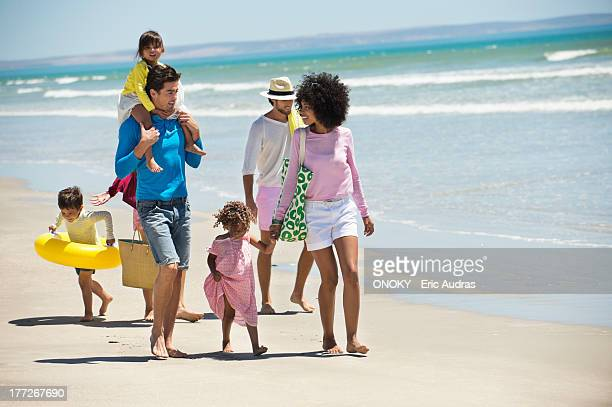 Families walking on the beach
