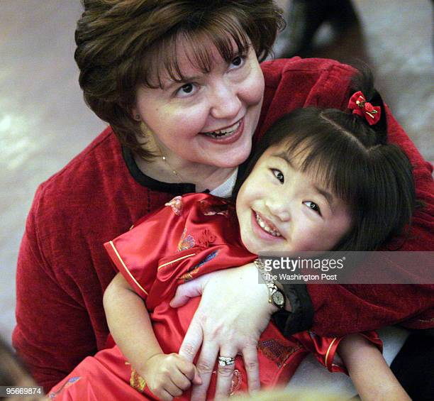Families with adopted children from China gather for their annual New Year's Day celebration PICTURED Lana Harrison and her daughter Elaina Ming Ming...