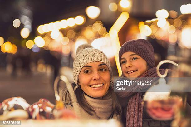 Familiy happiness with retro look Christmas market South Tyrol