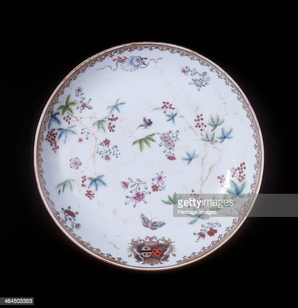 Famille rose continental armorial plate Qing dynasty China 17501775 A famille rose armorial plate decorated with scrolling vines with red berries...