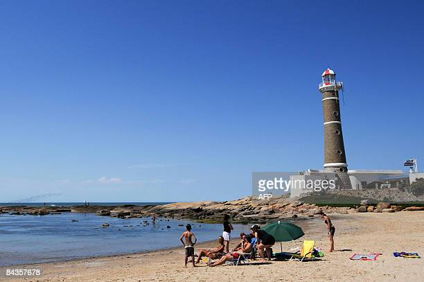 Familly of tourists enjoy Jose Ignacio beach, next to Punta del Este, one of the most exclusive seaside resorts of Latin America, 140 km from...