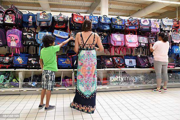 A familly shops at a supermarket in Labege near Toulouse on August 20 two weeks ahead of the start of the school year AFP PHOTO / REMY GABALDA
