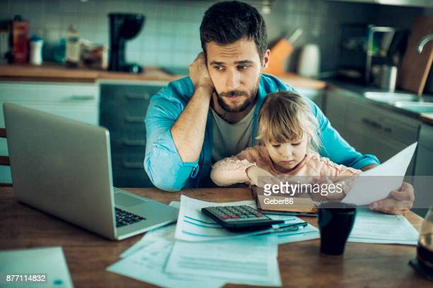 familt at home - financial bill stock pictures, royalty-free photos & images