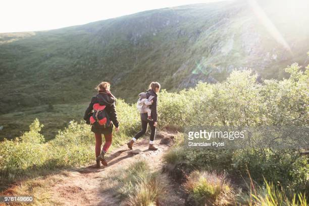 Familu trekking with kid in mountains