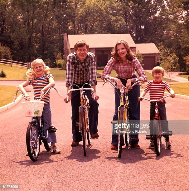 Family 4 Bicycle Portrait Mother Father Boy Girl Bikes Suburban Street House Suburbia Families Retro.