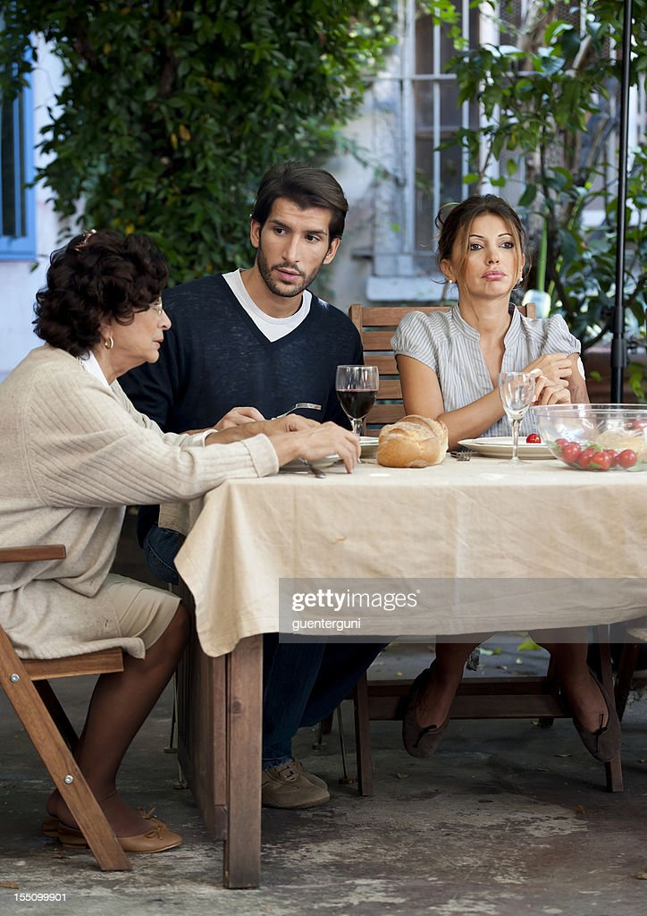 Family affairs - mother, son and daugher in law : Stock Photo
