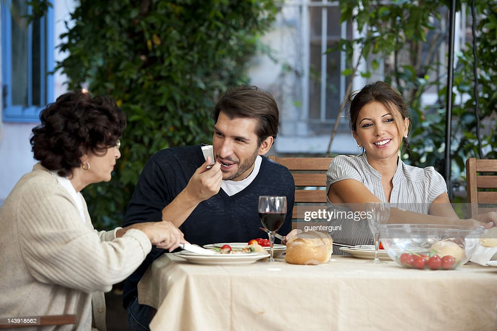 Family affairs - young couple and mother : Stock Photo