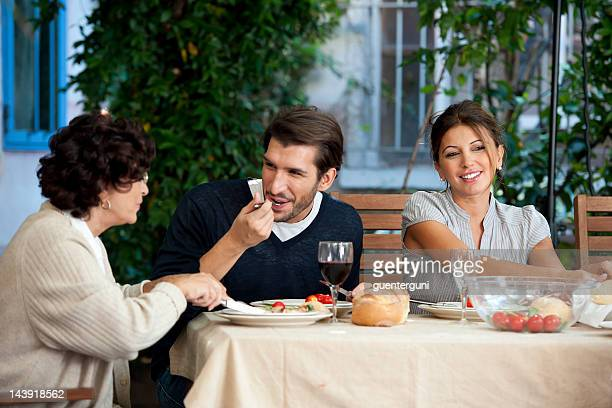 family affairs - young couple and mother - mother in law stock pictures, royalty-free photos & images
