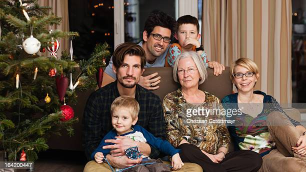 family and a christmas tree - christendom stockfoto's en -beelden