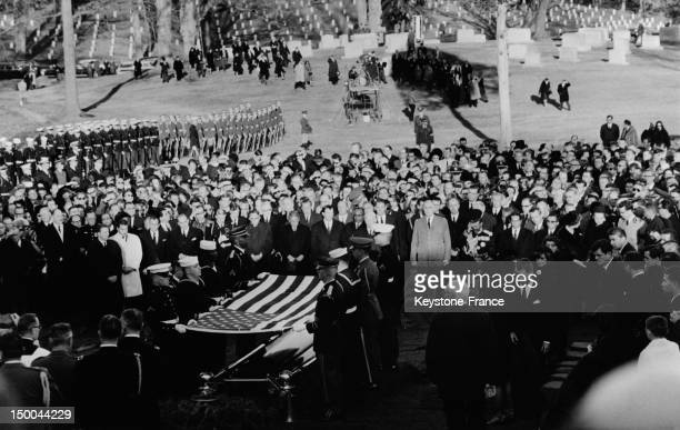 Family and chiefs of state pay their last respects in front of the coffin of late US President John Fitzgerald Kennedy at the cemetery during his...