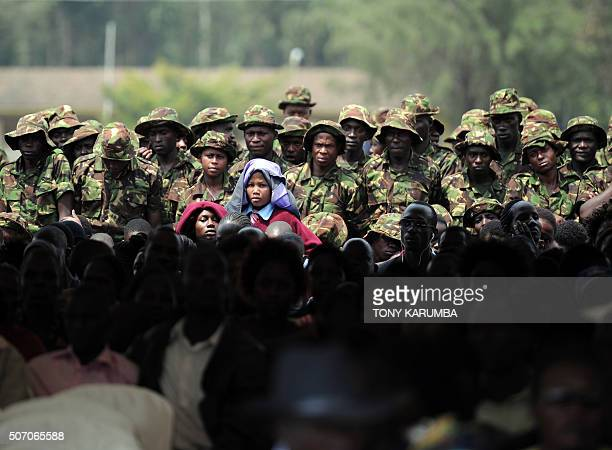 Family and comrades of slain Kenya Defence Forces soldiers wait to be addressed by Kenya's President Uhuru Kenyatta Somalia's Hassan Sheikh Mohamoud...