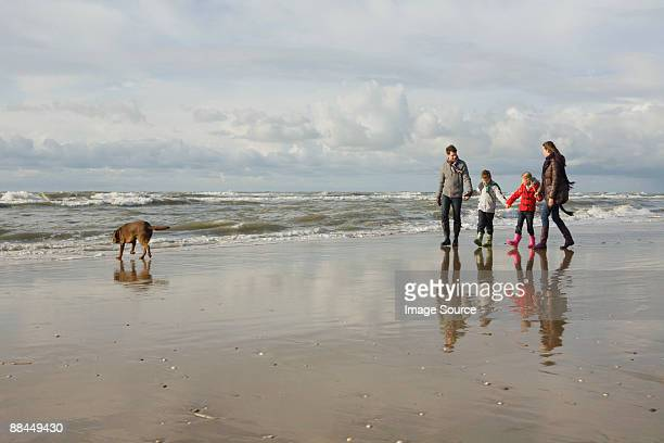 Family and dog by the sea
