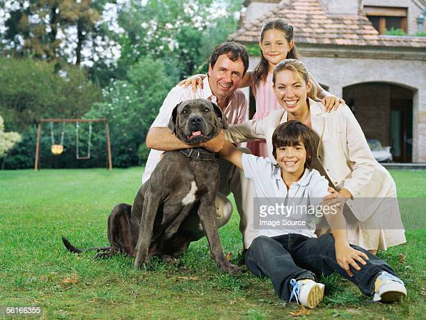 Family and dog in the garden