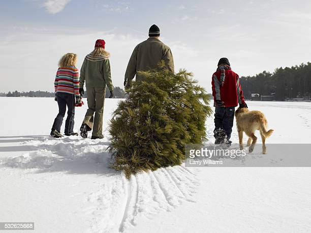 Family and Dog with Fir-Tree in the Snow