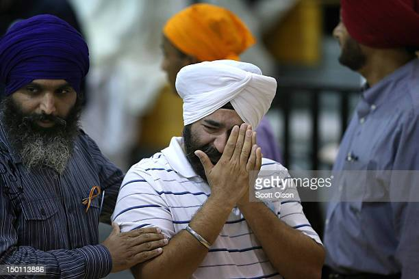 Family and friends and community members gather at Oak Creek High School to mourn the loss of 6 members of the Sikh Temple of Wisconsin on August 10...