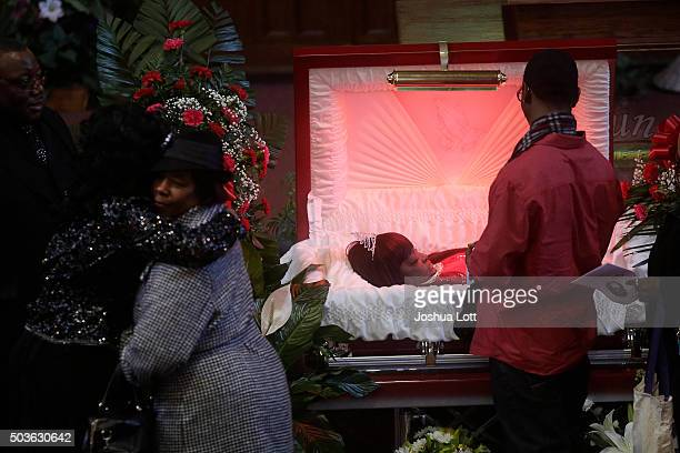 Family and friends attend the funeral for Bettie Jones at New Mount Pilgrim Missionary Baptist Church January 6 2016 in Chicago Illinois Bettie Jones...