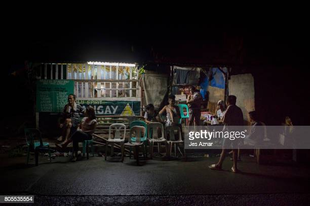Family and friends attend the wake of Manuel Borbe inside a village outpost on June 28 2017 in Manila Philippines Manuel was allegedly involved in...