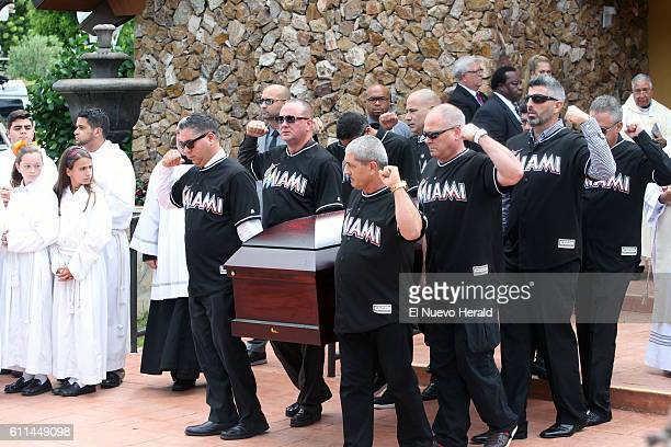 Family and friends carry the casket of Miami Marlins pitcher Jose Fernandez following a memorial service at St Brendan Catholic Church in Miami on...