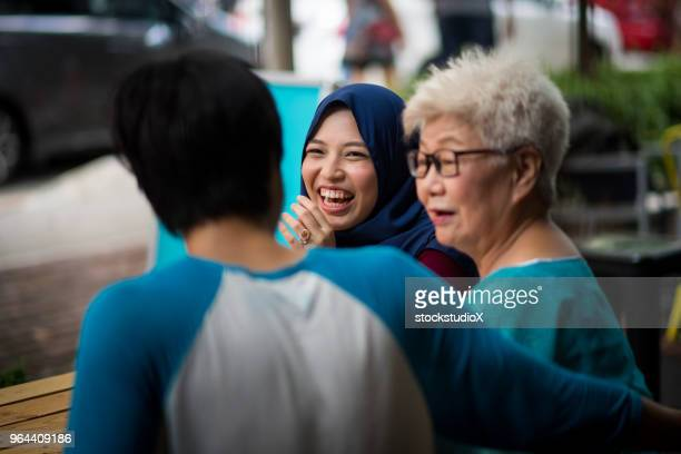 family and friends catching up at a cafe - islam stock pictures, royalty-free photos & images