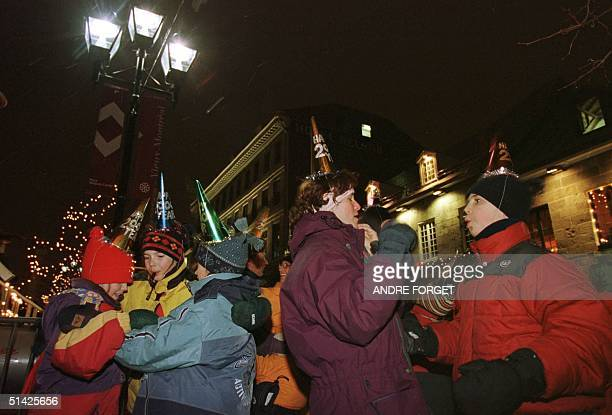 Family and friends celebrate the new year early with a dance to stay warm in Montreals' Place Jacques Cariter in the Old Montreal district 31...
