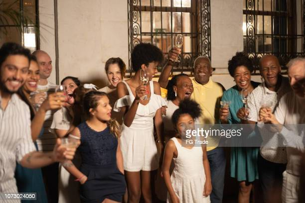 family and friends celebrating happy new year at home - african ethnicity photos stock pictures, royalty-free photos & images