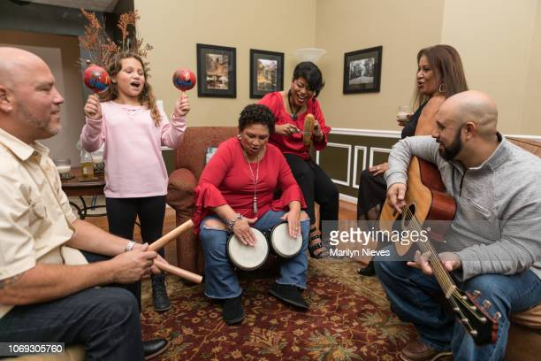 """family and friends celebrating with music - """"marilyn nieves"""" stock pictures, royalty-free photos & images"""