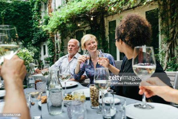 family and friends chatting at bbq - time of day stock pictures, royalty-free photos & images