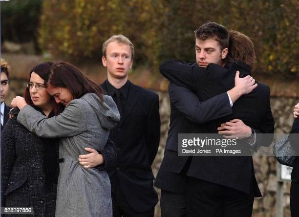 Family and friends comfort one another as the coffin of murdered British backpacker Katherine Horton is driven away from her funeral service at St...