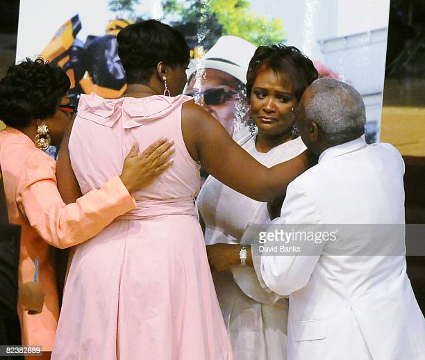 Family and friends console Bernie Mac's widow Rhonda McCullough at a memorial service for Bernie Mac at the The House of Hope Church on August 16...