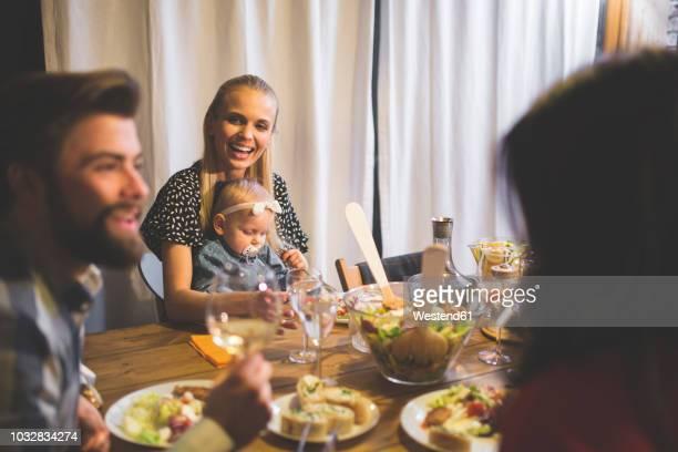 family and friends enjoying dinner, eating, drinking, having fun - quattro persone foto e immagini stock