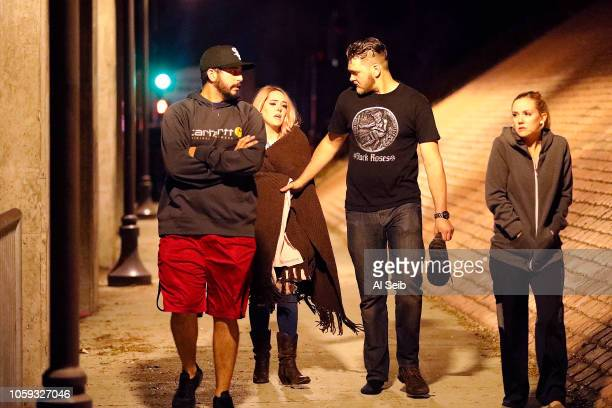 Family and friends escort Borderline attendees outside the shooting scene at the Borderline mass shooting on November 8 2018 in Thousand Oaks...