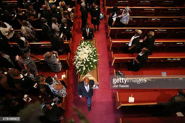 Family and friends follow pallbearers as they move the casket of Ethel Lance who was one of nine victims of a mass shooting at the Emanuel African...