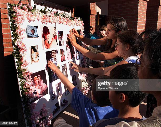 family and friends gather around memory board honoring Megan Barroso Sunday at Memorial service in Camarillo