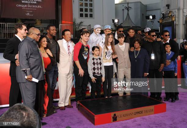 Family and friends gather around Michael Jackson's children during the Michael Jackson Hand And Footprint Ceremony at Grauman's Chinese Theatre on...