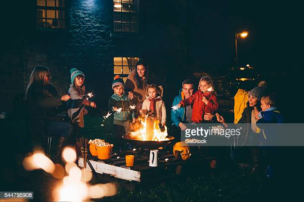 Family and Friends Gathered Around a Bonfire
