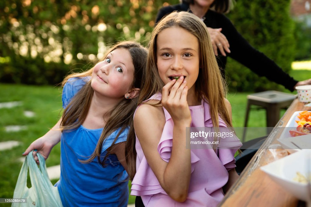 Family and friends gathering for party in backyard. : Stock Photo
