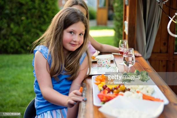 """family and friends gathering for party in backyard. - """"martine doucet"""" or martinedoucet stock pictures, royalty-free photos & images"""
