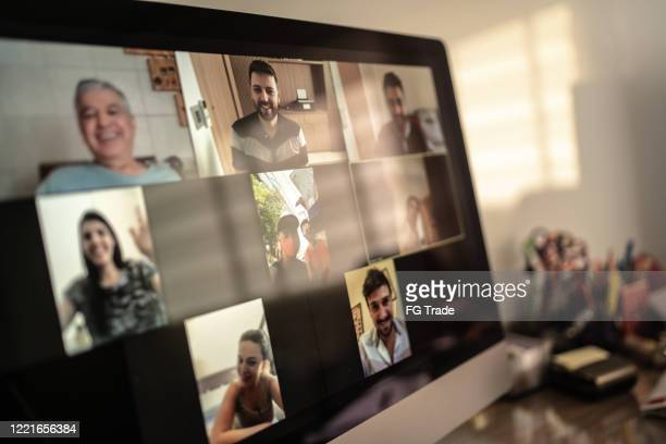 family and friends happy moments in video conference at home - device screen stock pictures, royalty-free photos & images