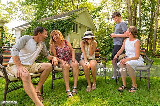 Family and Friends Having a Good Time in the Backyard