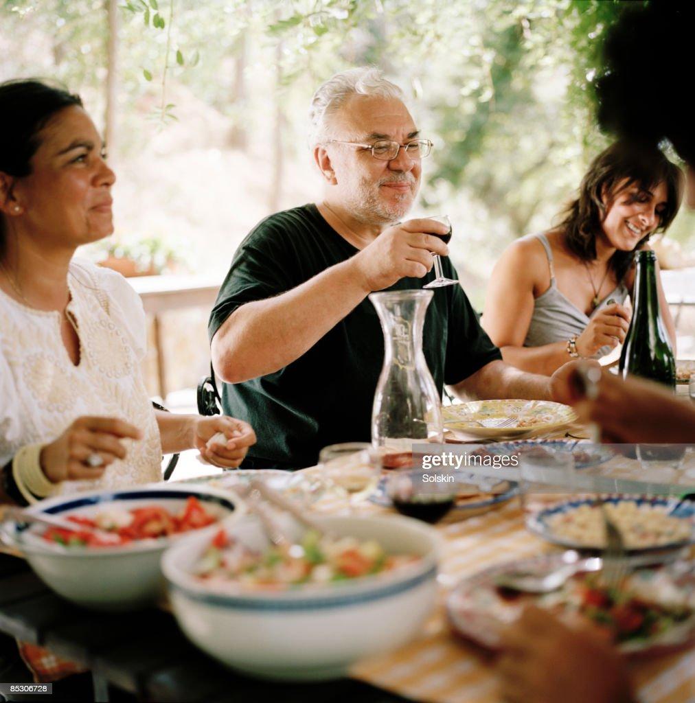 family and friends having garden dinner : Stock Photo